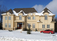 Luxury House In Winter. Luxury house in a winter setting royalty free stock image