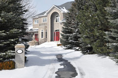 Luxury house in winter. Entrance to a luxury house in winter Stock Photography