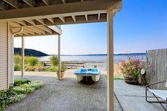 Luxury houses with exit to private beach., Burien, WA. Luxury houses with exit to private beach. Boat on backayrd patio and Pugert Sound view, Burien, WA royalty free stock photo