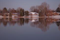 Luxury houses on a lake shore at dusk Stock Image