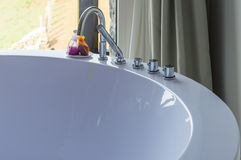 Luxury hydromassage round bath with chrome taps Royalty Free Stock Photography