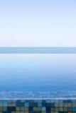 Luxury Infinity swimming pool Stock Image