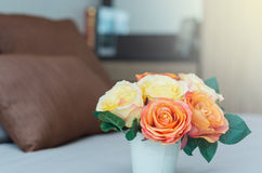 Luxury Interior bedroom with artificial rose flower on bed Royalty Free Stock Photos