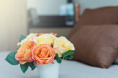 Luxury Interior bedroom with artificial rose flower on bed Royalty Free Stock Photo