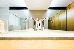 Luxury interior clean mens toilet. Wide angle focus on rounded t. Aps and bin it sign Stock Photo
