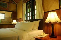 Luxury interior decor Asian resort bedroom & attached bathroom Stock Photo