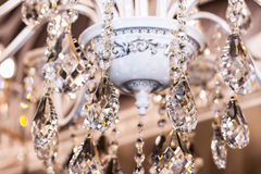 Luxury interior lighting decoration. Elements of crystal strass white lamp Royalty Free Stock Image