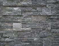 Luxury interior wall cladding made of dark gray natural stone. stock images