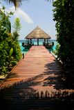 Luxury island resort. Looking along a wooden landing stage out to sea from a luxury resort on Filitheyo island in the Maldives Royalty Free Stock Photos