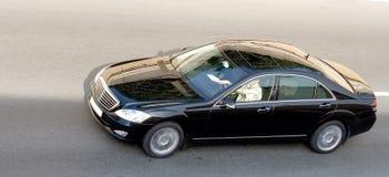 Luxury isolated german car. Luxury black german car speed on road Stock Photography