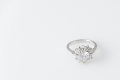 Luxury jewelry, shopping concept. White gold or silver ring with diamonds. Free space for text. Selective focus. Stock Photography