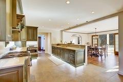 Luxury khaki kitchen interior with spaciuos dining area. Modern khaki kitchen room in large luxury house with bright dining area Stock Photo