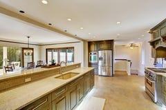 Luxury khaki kitchen interior with spaciuos dining area Stock Photo