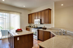 Luxury Kitchen. Wide view of kitchen with center island, countertops, and cabinetry Stock Image