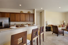 Luxury Kitchen. Ange of kitchen counter and bar chairs with view of living room Stock Photos