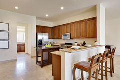 Luxury Kitchen. Wide view of kitchen with center island, countertops, and cabinetry Royalty Free Stock Image