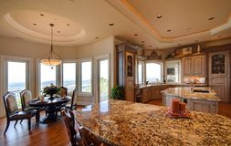 Luxury Kitchen. Ornate kitchen and dining area in luxurious new home royalty free stock photography