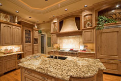 Luxury Kitchen. Ornate kitchen and dining area in luxurious new home Stock Photography