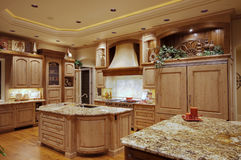 Luxury Kitchen. Ornate kitchen and dining area in luxurious new home royalty free stock photo