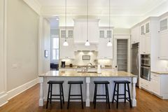 Luxury kitchen. Luxury eat-in kitchen with white cabinets and granite counters Royalty Free Stock Image