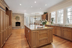 Luxury kitchen with fireplace Stock Photography