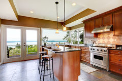 Luxury kitchen interior with water view. Stock Photos