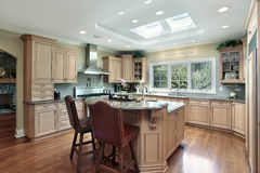 Luxury kitchen with oak wood cabinetry Stock Images