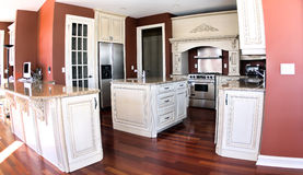 Luxury kitchen4. Picture of a luxury kitchen with antic finished cabinets and stainless steel appliances Royalty Free Stock Photography