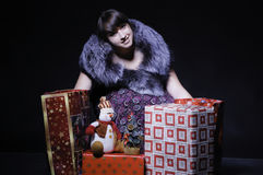 Luxury lady with christmas presents Stock Photos