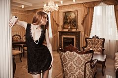 Luxury lady in luxury interior Stock Images