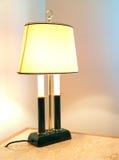 Luxury lamp. A luxury powered-on lamp on a desk Stock Photos