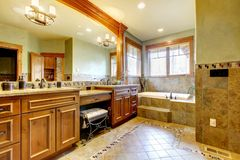 Luxury large master bathroom in mountain home. Royalty Free Stock Images