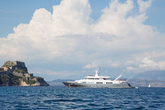 Luxury large super or mega motor yacht on anchor in corfu - greece. Landscape: Luxury large super or mega motor yacht on anchor in corfu - greece royalty free stock image