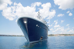 Luxury large super or mega motor yacht in the blue sea. Gigantic big luxury motor boat - yacht on the sea Stock Image