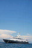 Luxury large super or mega motor yacht in the blue sea. Stock Photos