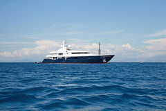 Luxury large super or mega motor yacht in the blue sea. Stock Photo