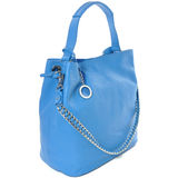 Luxury leather female bag isolated on white. Blue bag made of soft genuine leather with shoulder strap-chain Stock Photo
