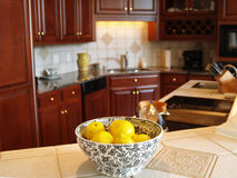 Luxury Lemons. A bowl of lemons on a marble countertop in a luxury kitchen Royalty Free Stock Photography