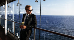 Luxury life. Portrait of the handsome and rich man. Shot from cruise liner. Sea on the background with copyspace stock photo