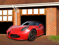 Luxury life sports car in garage Stock Photos