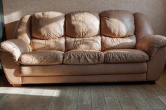 Luxury light brown leather comfortable sofa with soft cushions stock image