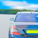Luxury limo race on a highway Royalty Free Stock Photo
