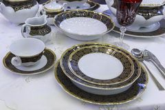Luxury linens on the holiday table. Dishes Royalty Free Stock Images