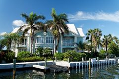 Luxury Living. A luxury waterfront building with palms Royalty Free Stock Images
