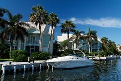 Luxury Living. A luxury waterfront building with yacht Royalty Free Stock Photography