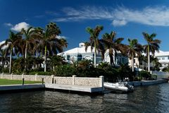 Luxury Living. A luxury waterfront building with palms Stock Photography