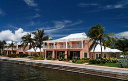 Luxury Living. A luxury waterfront building with palms Royalty Free Stock Photos