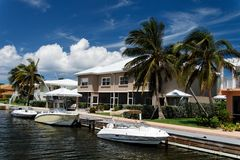 Luxury Living. A luxury waterfront building with yachts Royalty Free Stock Image