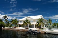 Luxury Living. A luxury waterfront building with jetski Royalty Free Stock Photo