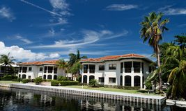 Luxury Living. A luxury waterfront building with palms Stock Photo